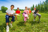 Kids hold sketch-boards — Stockfoto