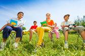 Happy children hold exercise books — Stock Photo