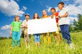 Children holding rectangular shape paper — ストック写真