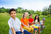 Five happy friends sit on chairs — Stock Photo