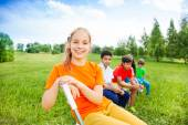 Five happy kids sit on chairs — Stock Photo