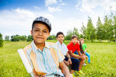 Five happy children sit on chairs — Stock Photo
