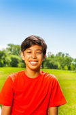 Brunet smiling boy in red T-shirt — Stock Photo