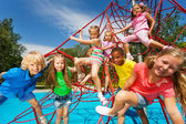 Many kids stand on red ropes — Stock Photo