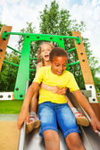 Boy start to slide on chute — Stock Photo