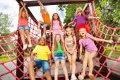Happy kids on net ropes — Stock Photo