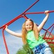 Girl on red rope of net — Stock Photo #52709409