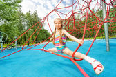 Active girl on red ropes — Stock Photo