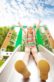 Girl on playground chute — Stock Photo
