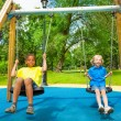 Two boys swing together — Stock Photo #52713225