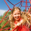 Happy girl on red rope net — Stock Photo #52714443