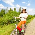 Pretty girl rides bike — Stock Photo #52715261
