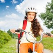Girl with long hair rides bike — Stock Photo #52715309