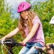 Girl and African boy on bikes — Stock Photo #52715353