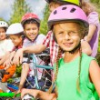 Girl in helmet and her friends — Stock Photo #52715361