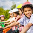 African guy with friends on bikes — Stock Photo #52715381