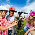 Smiling kids repair bike together — Stock Photo #52715399
