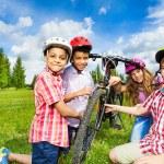 Happy children repair bicycle — Stock Photo #52715427
