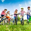 Постер, плакат: Children hold their bikes