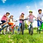 Children hold their bikes — Stock Photo #52715445