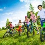 Row of children holding bikes — Stock Photo #52715457