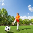 Boy kicking ball — Stock Photo #52718205