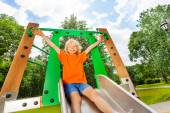Boy sliding on metallic chute — Stock Photo