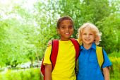 Two boys wearing school bags — Stock Photo