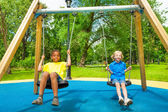 Two boys swing together — Stock Photo