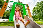 Pretty small girl on chute — Stock Photo