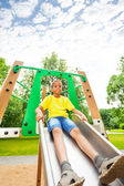 Boys holds sides of chute — Stock Photo
