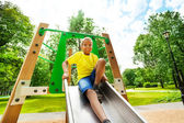 Smiling boys with bending knee on chute — Stock Photo