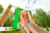 Funny girl on children chute — Stock Photo