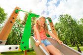 Funny girl on children chute — Stock Photo