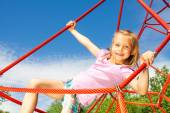 Girl on red net ropes — Stock Photo
