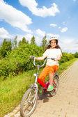 Pretty girl rides bike — Foto Stock