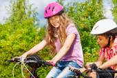 Girl and African boy on bikes — Stock Photo
