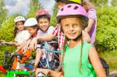 Girl in helmet and her friends — Stock Photo