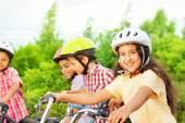 Small cute girl holds bike — Stock Photo