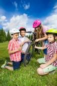 Happy kids repair bike — Stock Photo