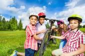 Happy children repair bicycle — Stock Photo