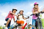 Laughing kids ready to ride — Stock Photo