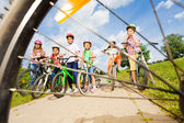 View from bicycle spoke on kids — Stock Photo