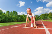 Smiling girl ready to run — Stock Photo