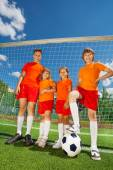 Children of different height with ball — Stock Photo