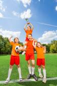 Happy kids with won cup — Stock Photo