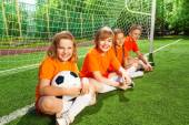 Children sit together with football — Stockfoto