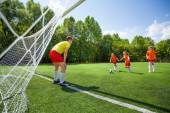 Children play football together — Foto Stock