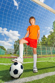 Boy in uniform with ball — Stock Photo