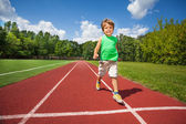 Cute small boy runs slowly — Stock Photo